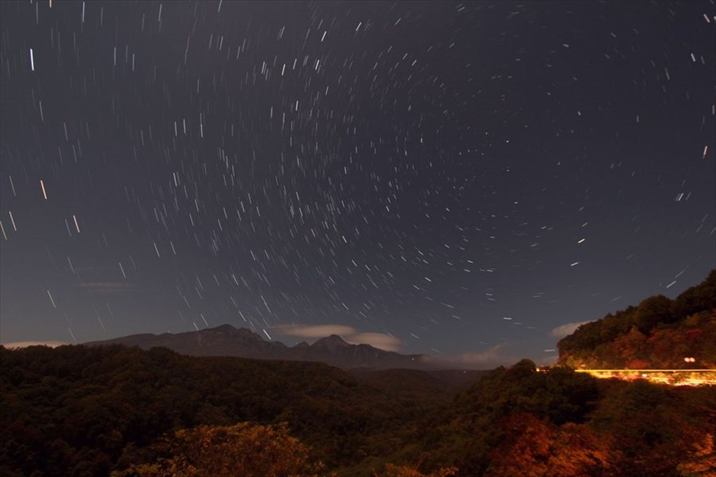 Mt. Yatsugatake and the starry sky viewed from Yatsugatake Highland Bridge in foliage season